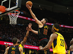 April 18, 2018 - Cleveland, OH, USA - The Cleveland Cavaliers' Larry Nance Jr., top, flies over the Indiana Pacers defense for a bucket in the fourth quarter in Game 2 of a first-round NBA playoff series on Wednesday, April 18, 2018, at the Quicken Loans Arena in Cleveland. The Cavs won, 100-97, to even the series. (Credit Image: © Leah Klafczynski/TNS via ZUMA Wire)