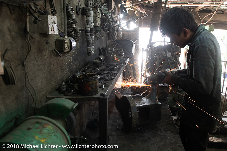 Repair shop in Kathmandu after our Himalayan Heroes motorcycling adventure, Nepal. Saturday, November 17, 2018. Photography ©2018 Michael Lichter.