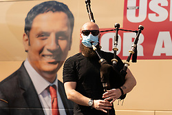 Glasgow, Scotland, UK. 5 May 2021. Scottish Labour Leader Anas Sarwar and former Prime Minister Gordon Brown appear at an eve of polls drive-in campaign rally in Glasgow today.  Masked piper entertains the crowd before speeches. Iain Masterton/Alamy Live News