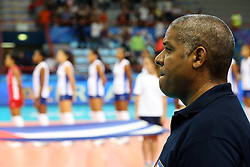 Cuba head coach Juan Carlos Gala Rodriguez listens to Cuba national anthem