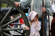 Civil War girl watches parade.