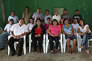 BSCFA members from San Joaquin village pose for a photograph after an event in the community center. Belize Sugar Cane Farmers Association (BSCFA). San Joaquin, Corozal, Belize. January 23, 2013.