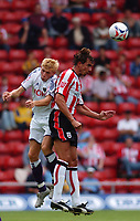 Photo: Alan Crowhurst.<br /> Southampton v Anderlecht, Pre Season Friendly, 30/07/2005. Claus Lundekvam heads to safety.
