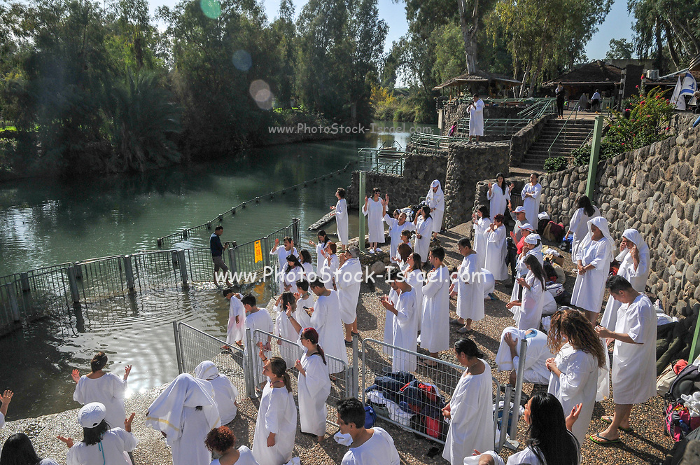 Israel, Yardenit Baptismal Site In the Lower Jordan River South of the Sea of Galilee, A group of pilgrims being Baptized