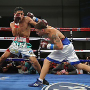 KISSIMMEE, FL - MARCH 06:  Jonathan Oquendo (R) throws a punch to the head of Gabino Cota as they fight for the WBO Latino Flyweight Title during the Telemundo Boxeo boxing match at the Kissimmee Civic Center on March 6, 2015 in Kissimmee, Florida. Oquendo won the belt after a 10 round unanimous decision on the scorecards. (Photo by Alex Menendez/Getty Images) *** Local Caption *** Jonathan Oquendo; Gabino Cota