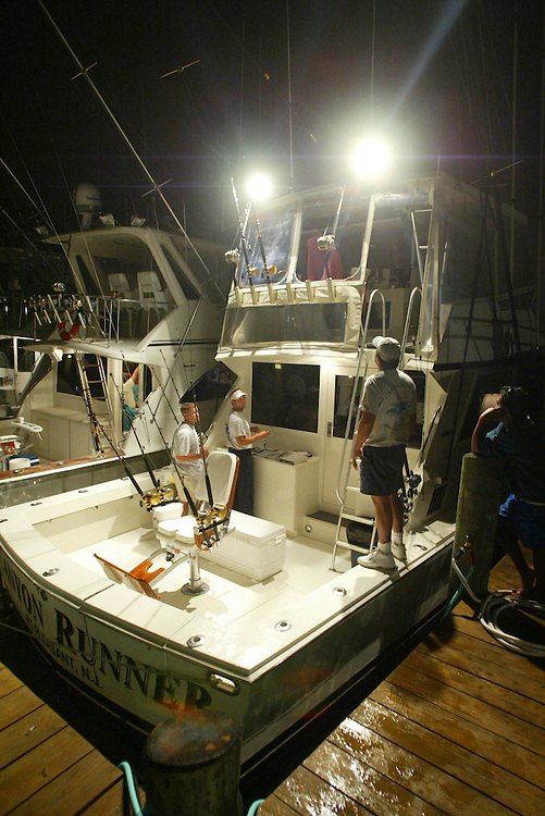 (SPORTS) Ocean City MD. 8/4/2003  Crew of the Canyon Runner start rigging the boat at 4am for day one of the White Marlin Tournament.   Michael J. Treola Staff Photographer.........MJT