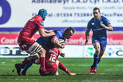 Leinster's Bryan Byrne is tackled by Scarlets' Steffan Hughes<br /> <br /> Photographer Craig Thomas/Replay Images<br /> <br /> Guinness PRO14 Round 17 - Scarlets v Leinster - Friday 9th March 2018 - Parc Y Scarlets - Llanelli<br /> <br /> World Copyright © Replay Images . All rights reserved. info@replayimages.co.uk - http://replayimages.co.uk