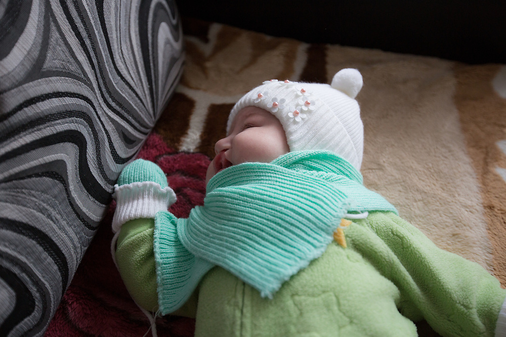 CAPTION: It's November in Volgograd, and temperatures are beginning to dip below freezing. Baby Valentina is wrapped up nice and warm, ready to join her parents on a trip to the shops. LOCATION: Volzhskiy, Volgograd Oblast, Russia. INDIVIDUAL(S) PHOTOGRAPHED: Valentina Panteleeyeva.