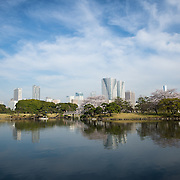 Hamarikyu Gardens in Ginza district of Tokyo with city skyline in background.