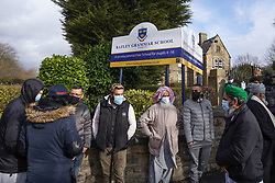 © Licensed to London News Pictures. 26/03/2021. Batley, UK. Parents gather outside Batley Grammar School, West Yorkshire, after a teacher showed cartoons of the Prophet Mohammed in a religious studies lesson. The teacher has been suspended from his role. Photo credit: Ioannis Alexopoulos/LNP
