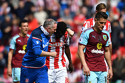 Stoke City manager Paul Lambert give a pep talk to team-mate Papa Badou Ndiaye at half time during the Premier League match at the bet365 Stadium, Stoke.