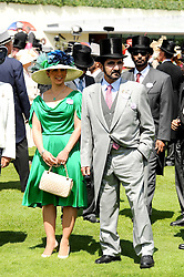 SHEIKH MOHAMMAD BIN RASHID AL MAKTOUM and his wife PRINCESS HAYA OF JORDAN at the third day of the Royal Ascot 2010 (Ladies Day) Racing Festival at Ascot Racecourse, Bershire on 17th June 2010.
