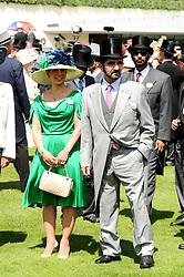 SHEIKH MOHAMMAD BIN RASHID AL MAKTOUM and his wife PRINCESS HAYA OF JORDAN at the third day of the Royal Ascot 2010 (Ladies Day) Racing Festival at Ascot Racecourse, Bershire on 17th June 2010.