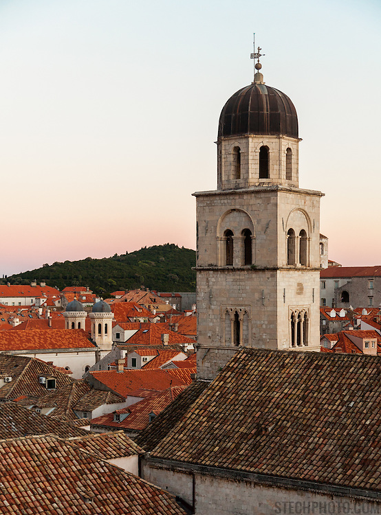 """The bell tower of the Franciscan Monastery above the old city of Dubrovnik, Croatia, at sunset. <br /> <br /> Dubrovnik serves as the official setting of """"King's Landing"""" from the popular TV show """"Game of Thrones""""."""