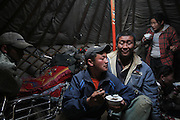 Sumtak having lunch with his friend in the commun yurt at Ulan Bulac mining site. Project about illegal gold mining in Mongolia where people from different backgrounds spend their summer and late summer trying to find minerals to get extra money for their lives.