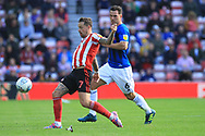 Chris Maguire and Harrison McGahey during the EFL Sky Bet League 1 match between Sunderland and Rochdale at the Stadium Of Light, Sunderland, England on 22 September 2018.