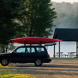 A car with a akayak at the boat lauch area at Lake Francis State Park in Pittsburg, New Hampshire.