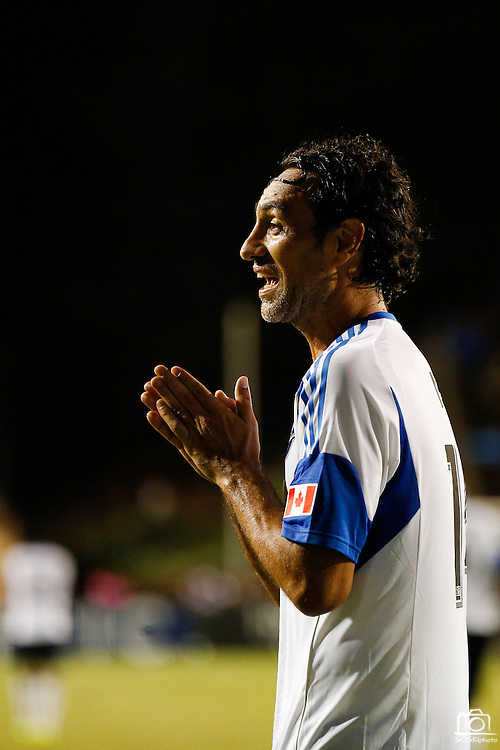 Montreal Impact defender Alessandro Nesta (14) pleads to a referee for a corner kick against the San Jose Earthquakes in the second half of the game at Buck Shaw Stadium in Santa Clara, California, on September 17, 2013.  The San Jose Earthquakes beat Montreal Impact 3-0. (Stan Olszewski/QMI Agency)