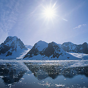 A sunrise over the Lemaire Channel on the Antarctic Peninsula, Antarctica.