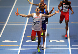 Poland's Jakub Krzewina celebrates winning the Men's 4x400m final during day four of the 2018 IAAF Indoor World Championships at The Arena Birmingham. PRESS ASSOCIATION Photo. Picture date: Sunday March 4, 2018. Photo credit should read Simon Cooper/PA Wire.