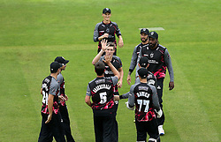 Jamie Overton of Somerset celebrates with teammates after taking the wicket of Michael Carberry of Hampshire - Mandatory by-line: Robbie Stephenson/JMP - 19/06/2016 - CRICKET - Cooper Associates County Ground - Taugnton, United Kingdom - Somerset v Hampshire - NatWest T20 Blast
