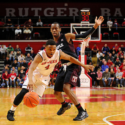 Myles Mack #4 of the Rutgers Scarlet Knights drives past Will Cummings #2 of the Temple Owls during the first half of Rutgers men's basketball vs Temple Owls in American Athletic Conference play on Jan. 1, 2014 at Rutgers Louis Brown Athletic Center in Piscataway, New Jersey.
