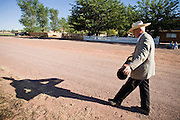 """June 16, 2008 -- COLORADO CITY, AZ: JOSEPH JESSOP, 86 years old, carries a water filter to his pickup truck in Colorado City, AZ. Jessop, a polygamist and member of the FLDS, was arrested during the Short Creek Raid in 1953 and had his wives and children taken from him for two years. Colorado City and neighboring town of Hildale, UT, are home to the Fundamentalist Church of Jesus Christ of Latter Day Saints (FLDS) which split from the mainstream Church of Jesus Christ of Latter Day Saints (Mormons) after the Mormons banned plural marriage (polygamy) in 1890 so that Utah could gain statehood into the United States. The FLDS Prophet (leader), Warren Jeffs, has been convicted in Utah of """"rape as an accomplice"""" for arranging the marriage of teenage girl to her cousin and is currently on trial for similar, those less serious, charges in Arizona. After Texas child protection authorities raided the Yearning for Zion Ranch, (the FLDS compound in Eldorado, TX) many members of the FLDS community in Colorado City/Hildale fear either Arizona or Utah authorities could raid their homes in the same way. Older members of the community still remember the Short Creek Raid of 1953 when Arizona authorities using National Guard troops, raided the community, arresting the men and placing women and children in """"protective"""" custody. After two years in foster care, the women and children returned to their homes. After the raid, the FLDS Church eliminated any connection to the """"Short Creek raid"""" by renaming their town Colorado City in Arizona and Hildale in Utah.   Photo by Jack Kurtz"""