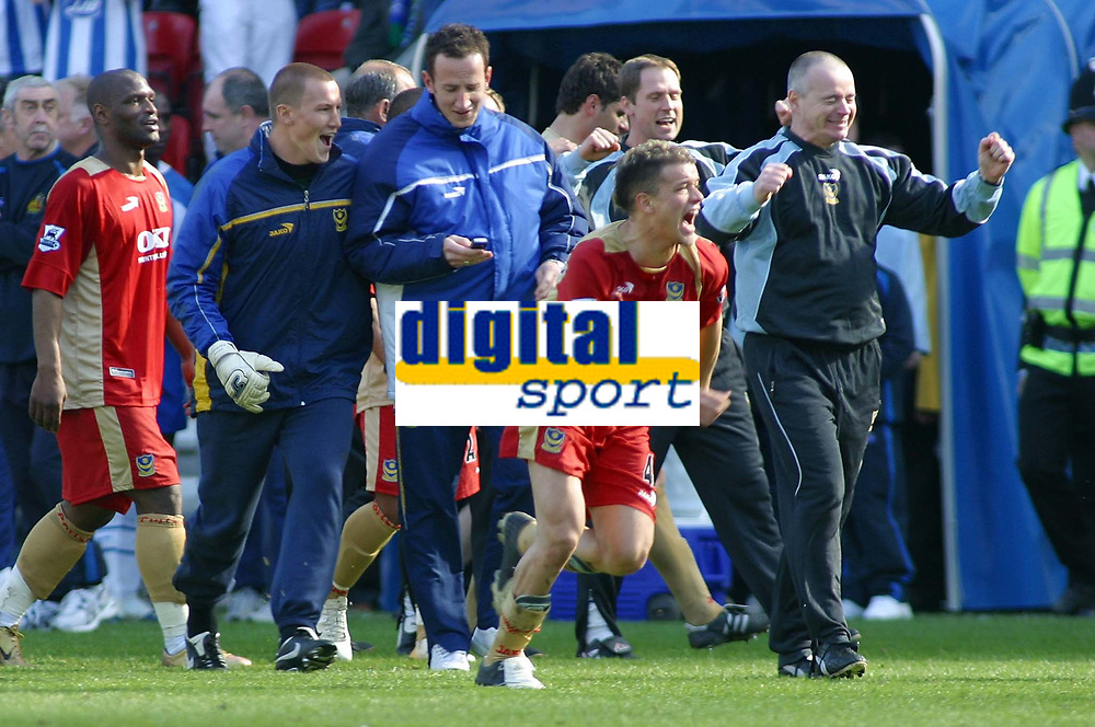 Photo: Paul Thomas.<br /> Wigan Athletic v Portsmouth. The Barclays Premiership. 29/04/2006.<br /> <br /> Andres D'Alessandro and his Portsmouth team celebrate the news from the phone that they are staying up.