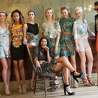 Designer Saloni poses with models showing her autumn/spring 2010/2011 collection during a fashion show held in the map room of the Royal Geographical Society, South Kensington, London on 20 September 2010.