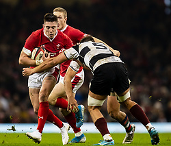 Josh Adams of Wales under pressure from Tyler Ardron of Barbarians <br /> <br /> Photographer Simon King/Replay Images<br /> <br /> Friendly - Wales v Barbarians - Saturday 30th November 2019 - Principality Stadium - Cardiff<br /> <br /> World Copyright © Replay Images . All rights reserved. info@replayimages.co.uk - http://replayimages.co.uk