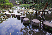 """Stepping Stones at Heian Shrine Pond Garden - the shrine is surrounded by beautiful chisen-kaiyu-shiki which literally means """"pond-stroll"""" gardens on three sides of the main structures."""