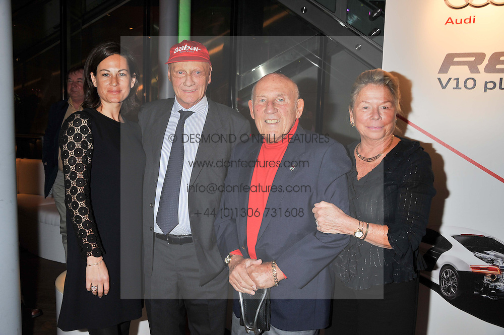 Left to right, NIKI & BIRGIT LAUDA and SIR STIRLING & LADY MOSS at the Motor Sport magazine's 2013 Hall of Fame awards at The Royal Opera House, London on 25th February 2013.