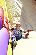 Tyler Robertson,4, enjoys the inflatable slide