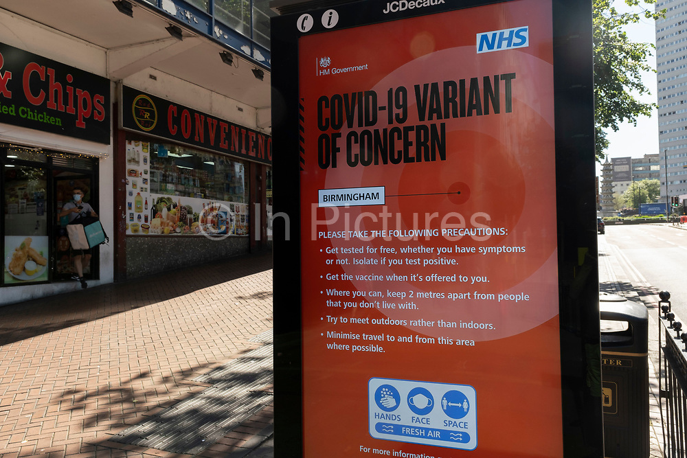 Covid-19 variant of concern public health NHS advertising board a the coronavirus restrictions continue and the government is about to announce an extension to the original freedom day planned for June, slowing the process of easing, more and more people begin to come to the city centre on 15th June 2021 in Birmingham, United Kingdom. After months of lockdown, the first signs that life will start to get back to normal continue, with more people enjoying the company of others in public, while uncertainty continues for a projected further month, which is being dubbed The final push.
