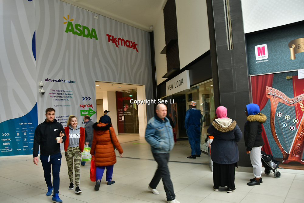 During the coronavirus in UK lockdown seen people queue outside ASDA with a 2 meter distant away each other, at Walthamstow Shopping mall,on 28 March 2020 London.