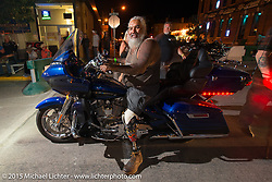 Malaquiasp Lujan on Main Street during the 75th Annual Sturgis Black Hills Motorcycle Rally.  SD, USA.  August 1, 2015.  Photography ©2015 Michael Lichter.