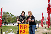 The Indigo Girls, Amy Ray and Emily Saliers perform at an encampment on the National Mall as the Cowboy and Indian Alliance (CIA), a group of ranchers, farmers and indigenous leaders, protest the Keystone XL pipeling in Washington, District of Columbia, U.S., on Tuesday, April 22, 2014. The groups are hosting an encampment on the National Mall for a week's worth of actions against the Keystone XL tar sands pipeline.
