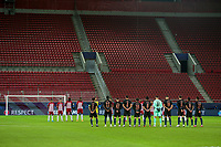PIRAEUS, GREECE - NOVEMBER 25: The two teams pay tribute to Diego Maradona prior to the UEFA Champions League Group C stage match between Olympiacos FC and Manchester City at Karaiskakis Stadium on November 25, 2020 in Piraeus, Greece. (Photo by MB Media)
