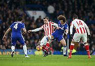 Chelsea's David Luiz tussles with Stoke'sXherdan Shaqiri during the Premier League match at Stamford Bridge Stadium, London. Picture date December 31st, 2016 Pic David Klein/Sportimage