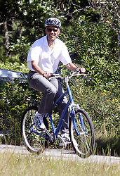 Malia Obama trails President Barack Obama during a family bike ride with daughter Malia and Sasha in Manuel Correllus State Forest in West Tisbury, MA, USA on August 27, 2010. First Lady Michelle Obama and daughter Sasha were ahead by about 30 seconds. Photo by Vincent DeWitt/ABACAPRESS.COM  | 241929_009 West Tisbury