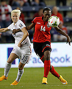United States' Megan Rapinoe (15) and Trinidad and Tobago's Karyn Forbes (14) battle for control of the ball during the second half of a CONCACAF Women's Championship soccer match, Wednesday, Oct. 15, 2014, in Kansas City, Kan.(AP Photo/Colin E. Braley)