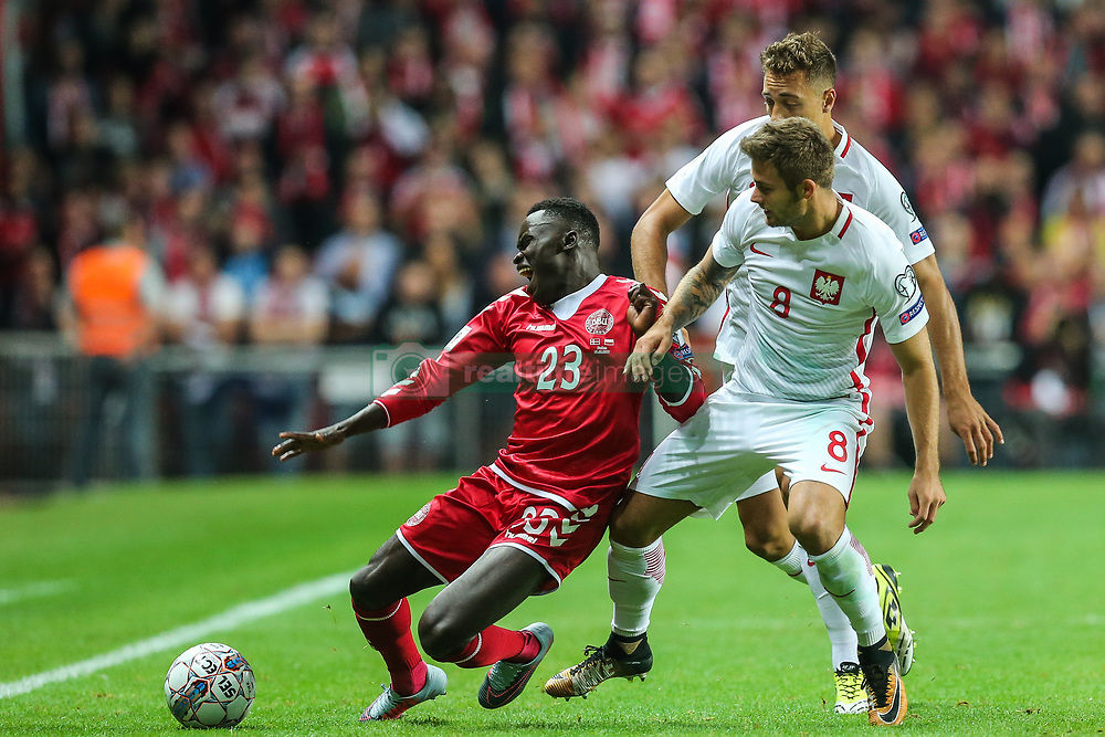 September 1, 2017 - Copenhagen, Denmark - Karol Linetty (POL), Pione Sisto (DEN), Thiago Cionek (POL),  during the FIFA 2018 World Cup Qualifier between Denmark and Poland at Parken Stadion on September 1, 2017 in Copenhagen. (Credit Image: © Foto Olimpik/NurPhoto via ZUMA Press)