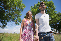 Happy mid adult couple walking in the countryside, Bavaria, Germany