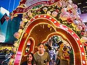 25 DECEMBER 2015 - SINGAPORE, SINGAPORE:  People walk through displays of Christmas themed holiday lights on Orchard Road in Singapore. Orchard Road is the heart of Singapore's upscale shopping and consumerism.    PHOTO BY JACK KURTZ