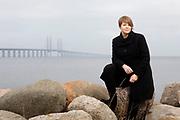 Portrait of Katrin Stjernfeldt Jammeh, Malmö, Sweden.<br /> The Oresund Bridge is seen in the background.<br /> Photo Ola Torkelsson ©