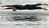 a competitor dives into the lake during the Corus Elite womens triathlon event in Tredegar,South Wales. pic by Andrew Orchard