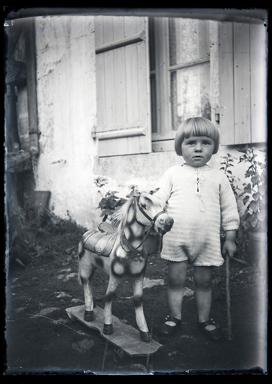 toddler with wooden play horse France circa 1920s