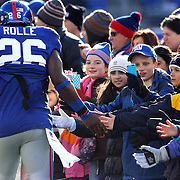 Children from Sandy Hook Elementary School welcome players onto the field as they form a guard of honor for the New York Giants before the start of the game. Sandy Hook Elementary School students, parents and faculty were honored by the Giants during a pre-game ceremony before the New York Giants V Philadelphia Eagles NFL American Football match at MetLife Stadium, East Rutherford, NJ, USA. 30th December 2012. Photo Tim Clayton