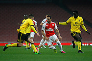 Santi Cazorla (c) in action for Arsenal up against Rory Hale (left) of Aston Villa. U21 Barclays Premier league play off final match, Arsenal U21's v Aston Villa U21's at the Emirates Stadium in London on Tuesday 10th May 2016.<br /> pic by Steffan Bowen, Andrew Orchard sports photography.