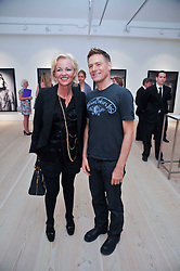 AMANDA ELIASCH and BRYAN ADAMS at an exhibition of photographic portraits by Bryan Adams entitled 'Hear The World' at The Saatchi Gallery, King's Road, London on 21st July 2009.